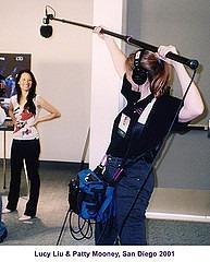 Sound Technician Patty Mooney booms Lucy Liu at SD Comic Con