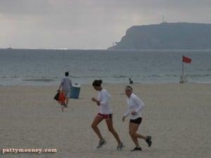 Girls running on Silver Strand Beach Coronado Island