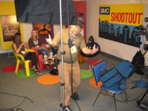 DP Jan Beran pans for camera inside Sunday Morning Shootout studio at SDCC